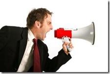 Man_yelling_into_megaphone