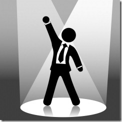 stick figure businessman in spotlight_thumb